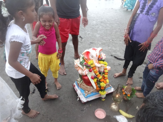 Small kids enjoying Ganesh festival