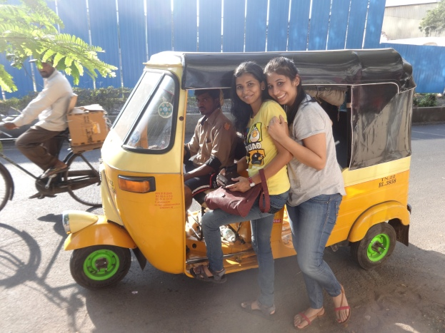 My friends posing with auto rickshaw driver